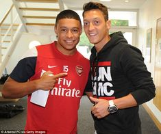 Friends already? Alex Oxlade-Chamberlain is among the first Arsenal players to meet Mesut Ozil