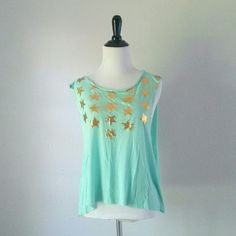 """Vintage Havana Turquoise Muscle Tank Turquoise muscle tank with gold star print by Vintage Havana. Has an unfinished hem and arm holes. In excellent condition!  