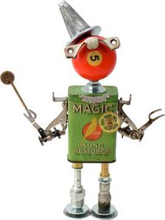 "Name: Teeny Houdini  D.O.B.: 8/30/11  Height: 11.5""  Principal Components: Bird food tin, pool ball, sash lock, cake decorating tip, sewing machine ruffle attachments, clock gear, hydraulic fittings    $325 SOLD"