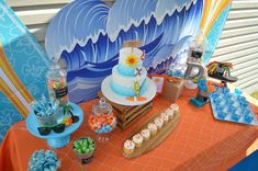 Amazing dessert table and backdrop at a beach birthday party! See more party planning ideas at CatchMyParty.com!
