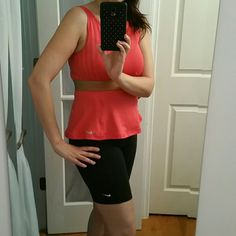 Cute! Peplum style tank top This top is pretty much new, just doesn't have tags. Very flattering fit. No internal bra. Coral color with a gold band. Nike Tops Tank Tops