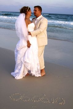 Beach Wedding...love color of his tux...and great photo idea!
