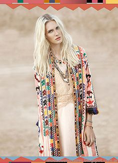 Navajo inspired kimono paired with a soft pink frock. Pretty eclectic outfit by Rapsodia.