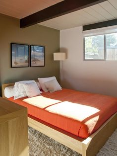 IKEA Malm platform bed. Love the contrasting orange bedspread. #midcentury #designpublic