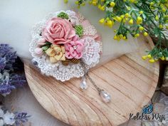Amarante Brooch  Size : 8,5 cm  Colours : pastel pink  Materials : ribbon flower, fabric flower, lace and beads