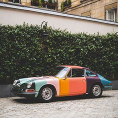 A special guest visited the #PaulSmith Paris showroom today. This 1965 Porsche 911 has been painted, inside and out, in the colours of the…