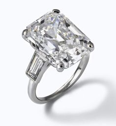 Grace Kelly's Engagement Ring Prince Rainier II of Monaco presented Grace Kelly with a 10.5 carat emerald-cut diamond ring from Cartier. Originally he proposed with a much more modest infinity diamond band.