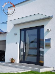 The Cologne model is a self-supporting glass-stainless steel canopy with minimalist .The Cologne model is a cantilever glass-stainless steel canopy with a minimalist look. A particularly load-bearing laminated safety glass pane made of special glass Modern Entrance Door, Modern Front Door, Front Door Entrance, House Entrance, Front Door Canopy, Porch Canopy, Bed Curtains, Door Design, House Design