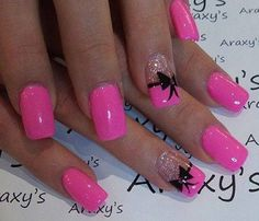 Wonderfully pink in this pink and glitter inspired bow nail art. Add awesome French tips into the ensemble to highlight the glitter nails and cap it off with cute little black ribbons.