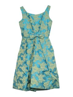50s -Missing Label- Womens teal blue and gold floral print sharkskin sheen rayon blend mid length, tank cut, fab fifties cocktail dress with squared neckline, darted bust, rear metal zip closure and oversized bow at mid waist piped seaming that falls to full, crinoline lined a-line skirt.