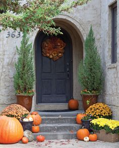 Nothing says fall in the South like a front porch adorned with pumpkins. Use these ideas to decorate your home's entrance with the season's signature motif.
