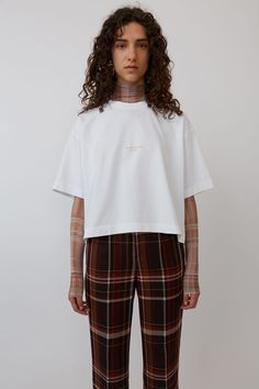Acne Studios Cylea optic white is a cropped, boxy fit t-shirt with a washed out Acne Studios logo at the centre front. Studio Logo, Direct Marketing, Acne Studios, Ready To Wear, Bell Sleeve Top, Ruffle Blouse, T Shirts For Women, How To Wear, Style