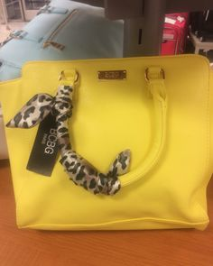 Saw this really cute #bcbg handbag .Its really cute how the handle is wrapped up with a scarf #handbag