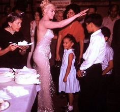 """A rare photo of Marilyn Monroe during her 34th birthday party on the set of """"Let's Make Love"""", 1960."""