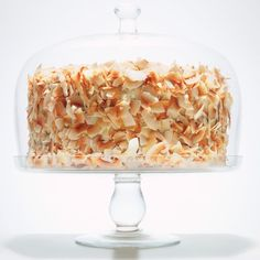 Coconut Southern Comfort Layer Cake -- bake in four layers as recipe states, but no need to split layers (or bake in three layers and split)