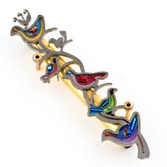 Colorful Doves of Peace Mezuzah from the Artazia Collection #805 GM by Seeka - Jewelry & Judaica. $119.00. Each Mezuzah Case is truly like a miniature artwork.. Kosher, hand written scroll from Israel, available separately from Seeka. Can be mounted indoors or outdoors under an overhang. Includes mounting screws a copy and a translation of the Mezuzah scroll, and placement instructions. Hand painting, followed by a variety of materials meticulously arranged inside the delic...