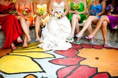 Colorful bridesmaid dresses with matching bouquets! And a very familiar-looking skirt... New Jersey aquarium wedding with SHARKS from JPG Photography | Offbeat Bride