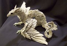 White Dragon Art made of light white clay by Ellen Jewett (Etsy shop Creatures from El) of Guelph, ON creaturesfromel