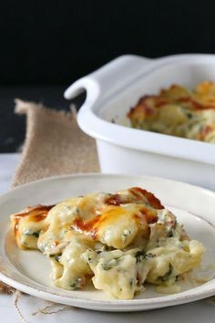 Baked gnocchi mac 'n' cheese recipe  Serves 2-4  Ingredients: ◦1 pound store-bought gnocchi ◦1 tablespoon unsalted butter ◦1 clove garlic, minced ◦1 tablespoon flour ◦1 cup whole milk ◦3/4 cup shredded sharp cheddar cheese, divided ◦1/3 cup shredded Parmesan cheese ◦1/2 cup chopped baby spinach ◦1/3 cup chopped crispy bacon