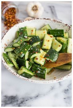 This Cucumber Salad with Garlic is an easy side dish that can be thrown together with just a few ingredients. It's flavorful and healthy and can be dressed up or down for any occasion. #thehungrytravelerblog #sidedish #saladrecipes