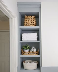 How to build built in bathroom shelves and a cabinet for your bathroom! DIY built in shelves adds both functional bathroom storage and pretty storage! A perfect small bathroom storage idea! #builtins #bathroomstorage #bathroomorganization