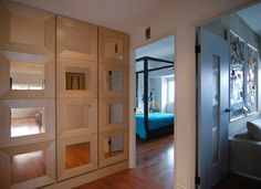 framed mirrors on the wall. Maybe do this but with a black matte paper inside for the entryway hall...