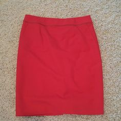 Calvin Klein pencil skirt Red with gold zipper detailing around waist band to add a polished modern look.  Slanted pockets, zipper in back.  Worn once Calvin Klein Skirts