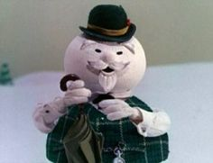 Burl Ives as The Snowman narrating Rudolph the Red Nosed Reindeer