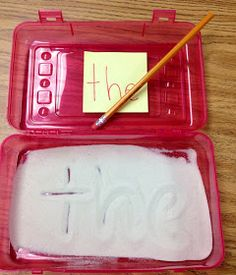 Writing in sand in a Sterilite Pencil Box.  Love this idea!