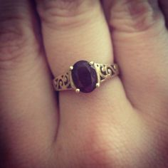 Garnet stone in a gold, filigree ring