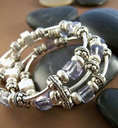Tanzanite Mystic Quartz cubes and sterling silver accent beads come together beautifully in this gorgeous memory wire bracelet.    Three