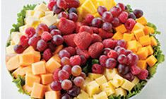 This platter features strawberries, cantaloupe, red grapes and pineapple paired with mild Cheddar, Jarlsberg and provolone cheeses. (Fruit selection subject to change based on seasonality.) Please note: the item shown in the photo is of the large tray. Cheese Tray Display, Cheese Fruit Platters, Cheese And Cracker Tray, Food Platters, Cheese Platters, Simple Cheese Platter, Catering, Food Porn, Party Trays