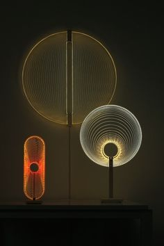 Arnout-Meijer-Studio-Thanks-for-the-Sun-series LED srip wrapped on the edges of a cnc scratched plexiglass shape.