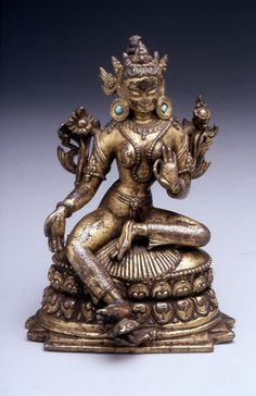 A Nepalese gilt-copper alloy and turquoise figure of the Tibetan tantric deity and the  Buddhist bodhisattva Tara; she sits in the 'lalitasana' posture on a lotus throne and her left-hand makes a mudra signifying teaching, while her right arm makes a mudra symbolising charity. (Walters Museum of Art)