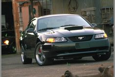 2001 Mustang Bullitt and Ford celebrates 100 years. Ford Mustang Bullitt, Ford Mustangs, 2002 Ford Mustang, Green Mustang, New Edge Mustang, Frontier Truck, Steve Mcqueen Bullitt, Ford Edge, Sweet Cars