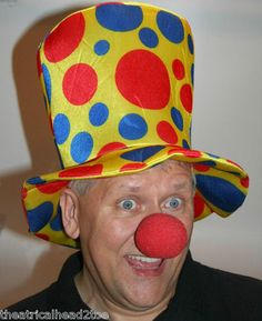 """Foam Clown High Top Hat Fancy Novelty Costume Parade Over sized Jumbo Circus Prop   eBay $15.99 FREE shipping. This 15"""" tall costume hat would be great for a clown, comedian, circus, face painter, balloon artist, costume accessory, Stretch foam hat will fit many sizes between teen to adult. Hat features multi-colored spots on a yellow background. This synthetic polyester and foam hat can be gently hand washed and air dried."""