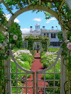 Rear gardens of the Mayflower Society House in Plymouth, Massachusetts.... all nice and pretty... but the BEST part is directly behind where the photographer stood:  the Mayflower Society Library-- chock-full of Pilgrim, New England, and American history!  A treasure trove, visit it someday!