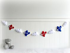 Airplane garland - banner - bunting - You pick your colors - custom made - airplane wall hanging - nursery decor - red, white and blue. $67,00, via Etsy.