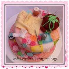 Sewing bee cake for my best friend, Lorraine. Apart from the 'cake stamen' pins, everything is edible.