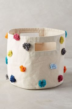 Anthropologie Rainbow Tufts Basket ***diy basket, stiff fabric and glue gun? Anthropologie Home, Over The Rainbow, Nursery Decor, Diy And Crafts, Sewing Projects, Textiles, Crafty, Gifts, Bags