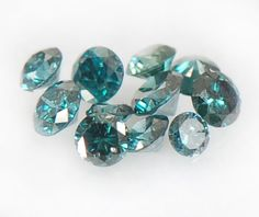 Google Image Result for http://i00.i.aliimg.com/photo/v0/111142094/Certified_Natural_Blue_Diamonds_0_25_ct.jpg