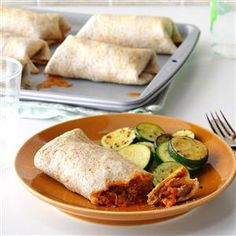 Italian Burritos Recipe -No beans about it: Nothing but beef, cheese, garlic and sauce is stuffed inside these baked burritos. My family is very picky, so I came up with these to satisfy everyone—and it worked! —Donna Holter, Centennial, Colorado