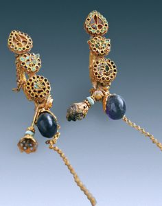 Earrings found in the grave of Han Farong, the wife of Magistrate Cui Zhen, of the Northern Wei dynasty of China. Dates to ca. 550 CE. Gold & gemstones.