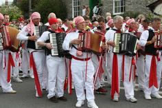 Red Oss supporters playing thier accordions and melodions May Days, British American, Tourist Information, More Photos, Cornwall, All Over The World, The Locals, Big Day, Scene