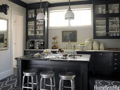 Dark cabinetry creates a classic Edwardian feeling. Design: Stephen Shubel