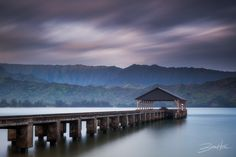Another Place in Time - A two minute exposure at sunrise captures the beginning of a new day as the sun begins to light up the mountains behind Hanalei Pier on the island of Kauai.  © Brian Hiltz www.brianhiltz.com