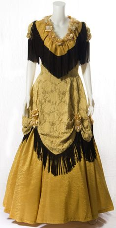 Google Image Result for http://www.costumesofnashua.com/CNWebSite105/Active905/Pages/CostumeRental/Western/Pics%2520Western/YellowCowgirlBrownTrim1.jpg