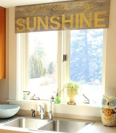 Turn a sign made from old barn wood and stenciled with happy song lyrics into a nontraditional window treatment that will brighten your day as much as the sunlight streaming in. Get the tutorial at At Home on the Bay    - CountryLiving.com