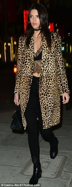 Wild about the coat: The 20-year-old wore a warming leopard print coat over a skimpy lace crop top