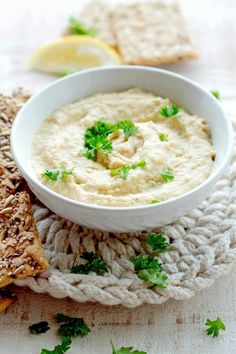 Still being new to the hummus making world I've come to realize that garlic is pretty much a staple when making it.  It's a huge flavor booster to an otherwise flavorless garbanzo bean or chickpea.  What I also discovered today while making this recipe is that lemon juice gives hummus a wonderful bright flavor that is absolutely amazing. This may be common knowledge to veteran hummus makers, but for me, being a newbie, it was a light bulb moment. While the garlic in the recipe lent it's…